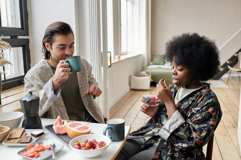 Couple eating food together