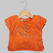 Orange Blouse with Swarovski Work and Beige Jacquard Ghaghra