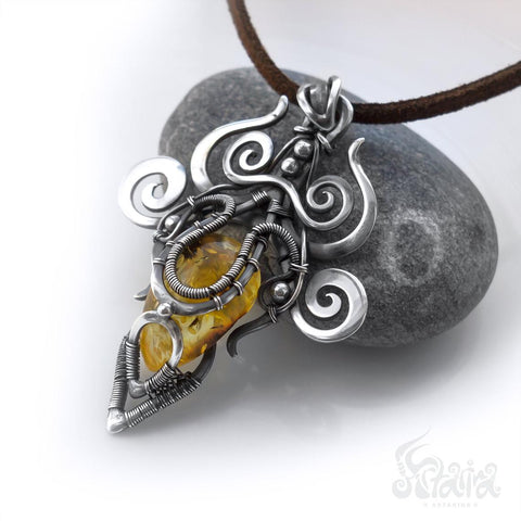 Silver wire wrapped necklace with amber