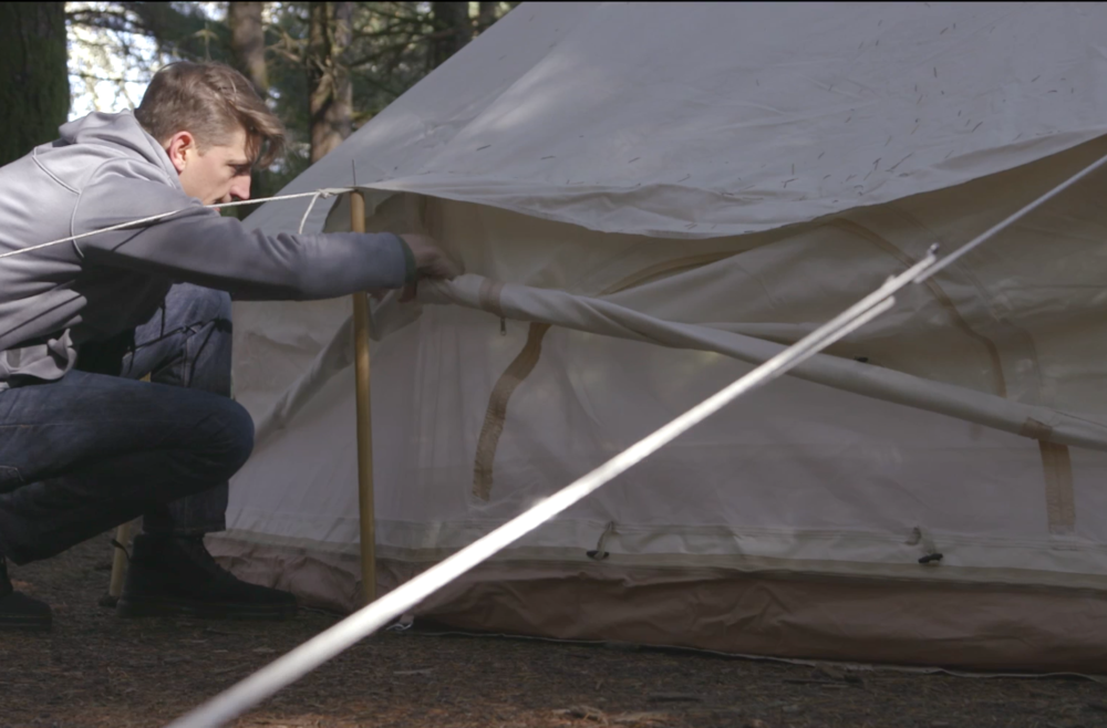 Rolling up bell tent wall