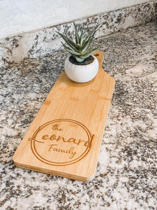 Engraved serving bamboo paddle board