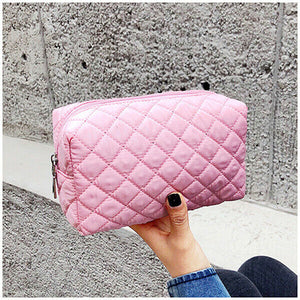 Lady hold the pink make up bag
