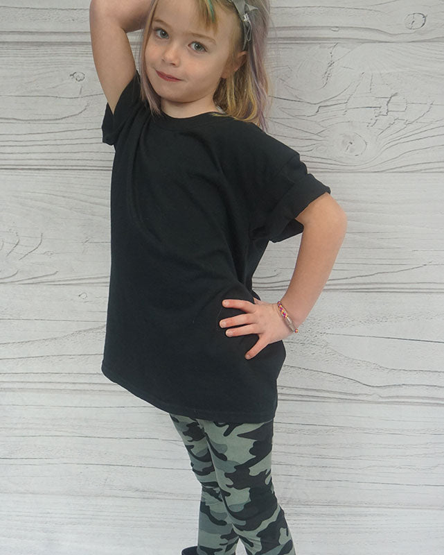 Child wearing gray camouflage leggings