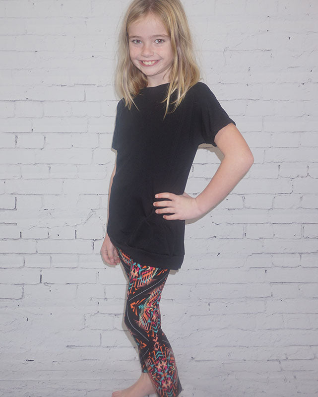 CHILD WEARING COLOURFUL LEGGINGS