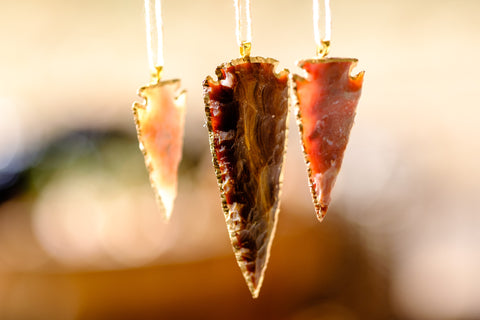 Agate Arrowhead christmas ornaments are a perfect gift.  Carved arrowheads for your tablescape.