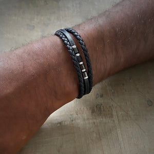 Black braided leather bracelet with stainless steel beads