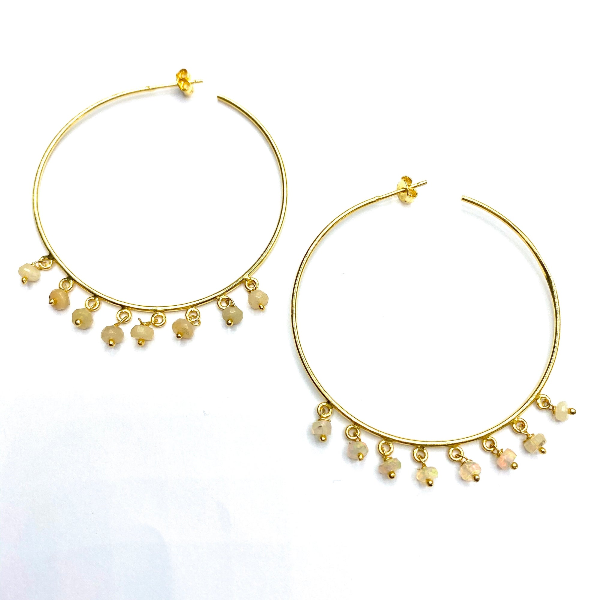 Large gold hoops with opal