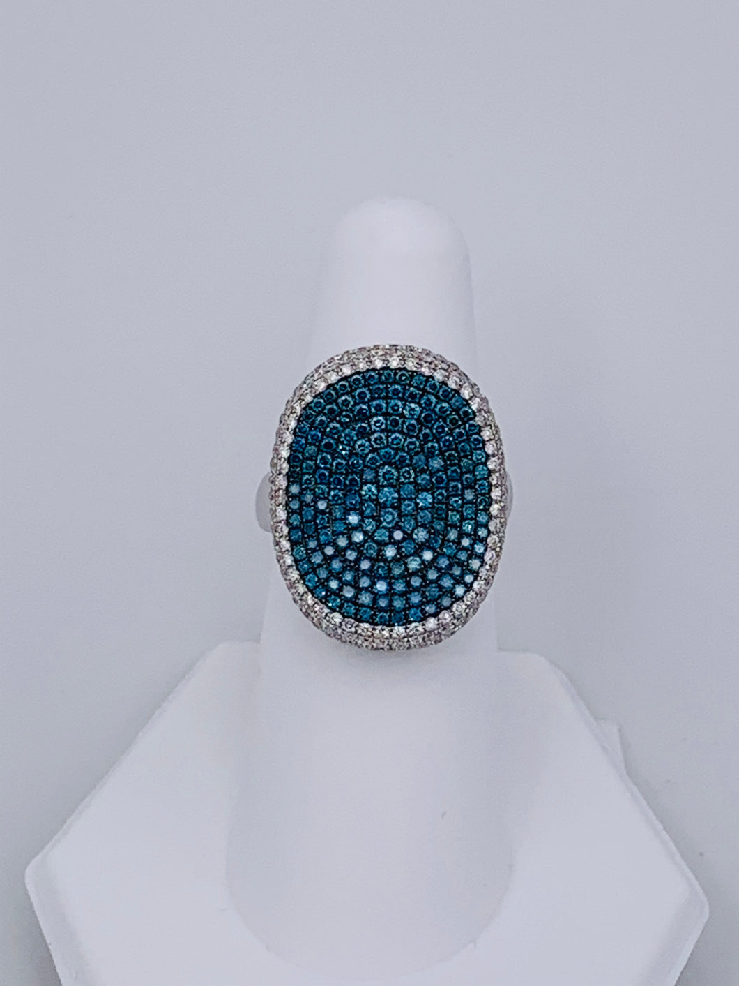 18 Karat White Gold Concave Blue and White Diamond Ring