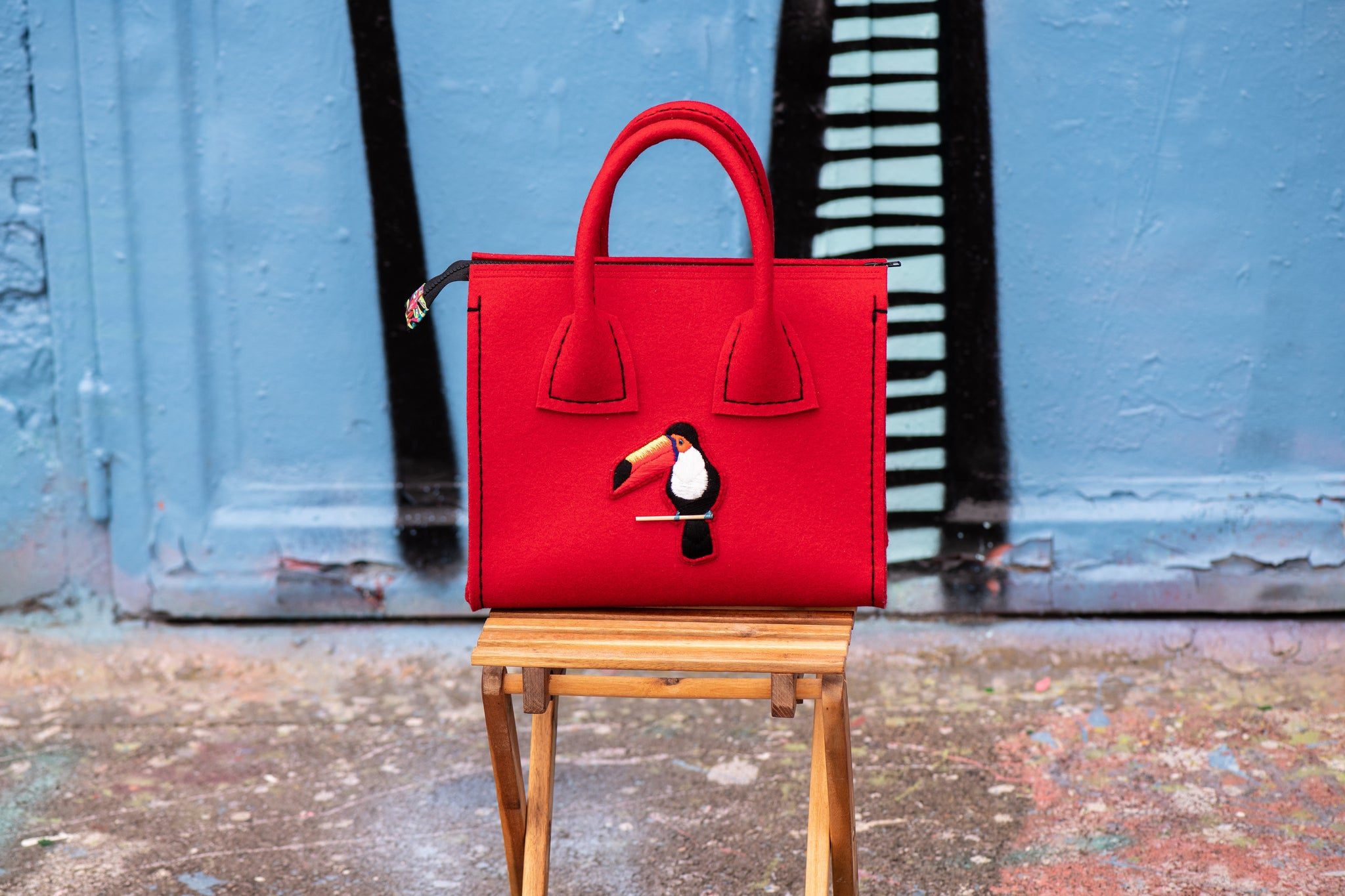 Luxury and hand-embroidered felt handbag, made in Luxembourg.