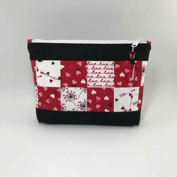 Red, white and pink squares on black:  Zippered Pouch