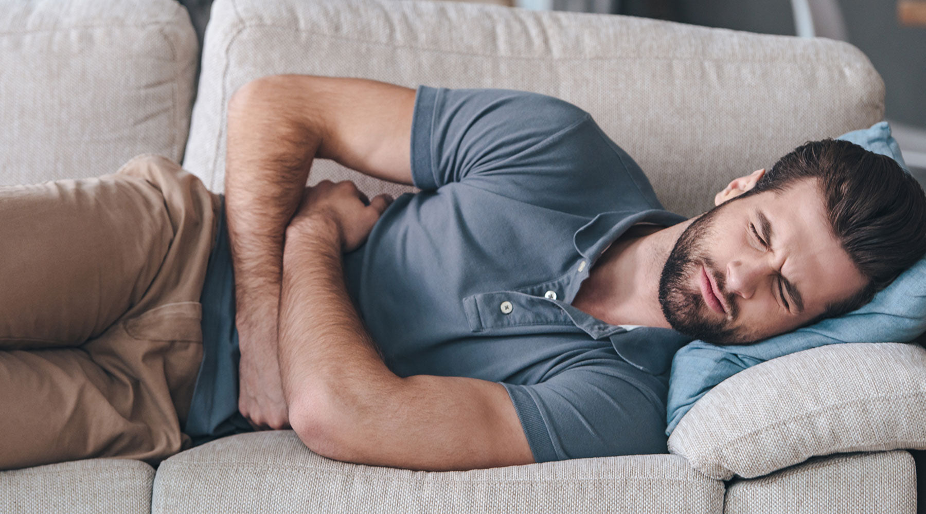 man with bad GERD trying nap on couch