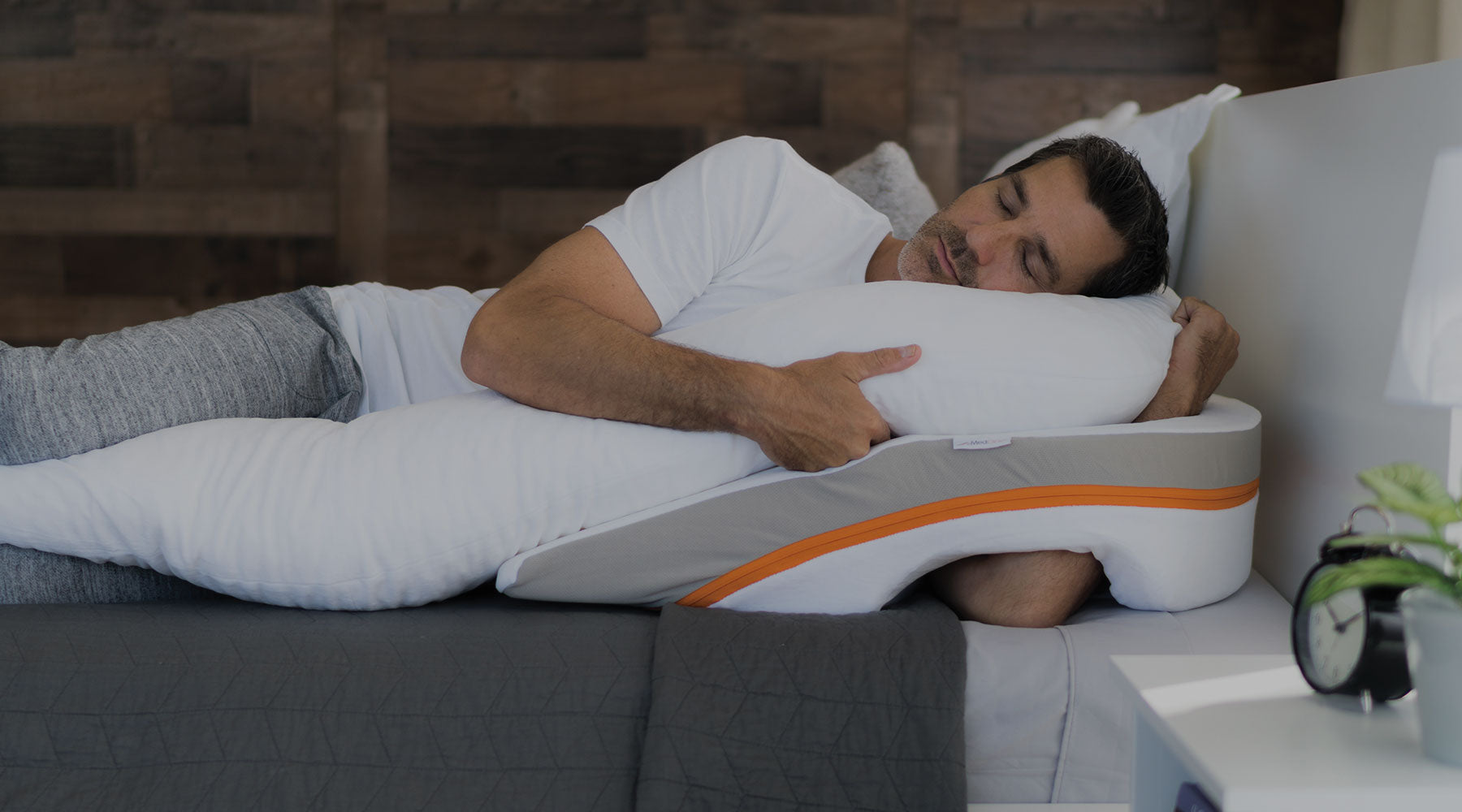man sleeping on GERD relief pillow