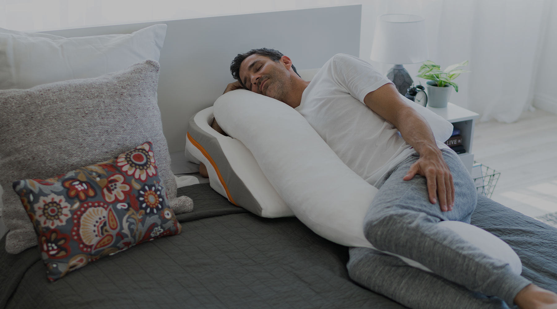 man sleeping on bed with medcline system