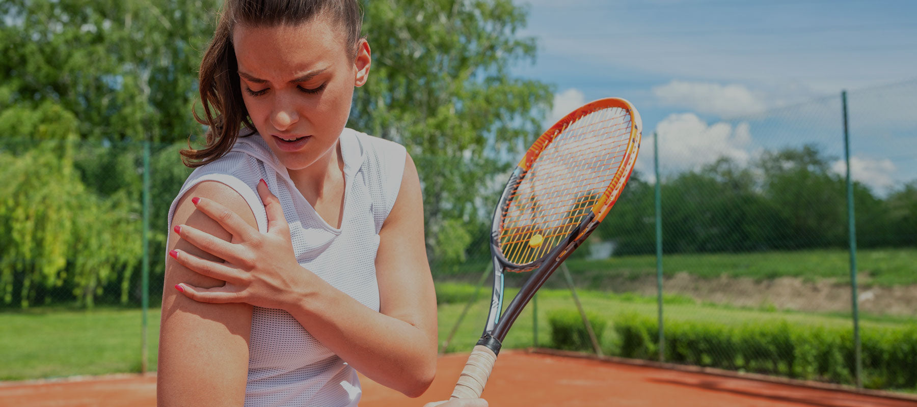 woman playing tennis with shoulder pain