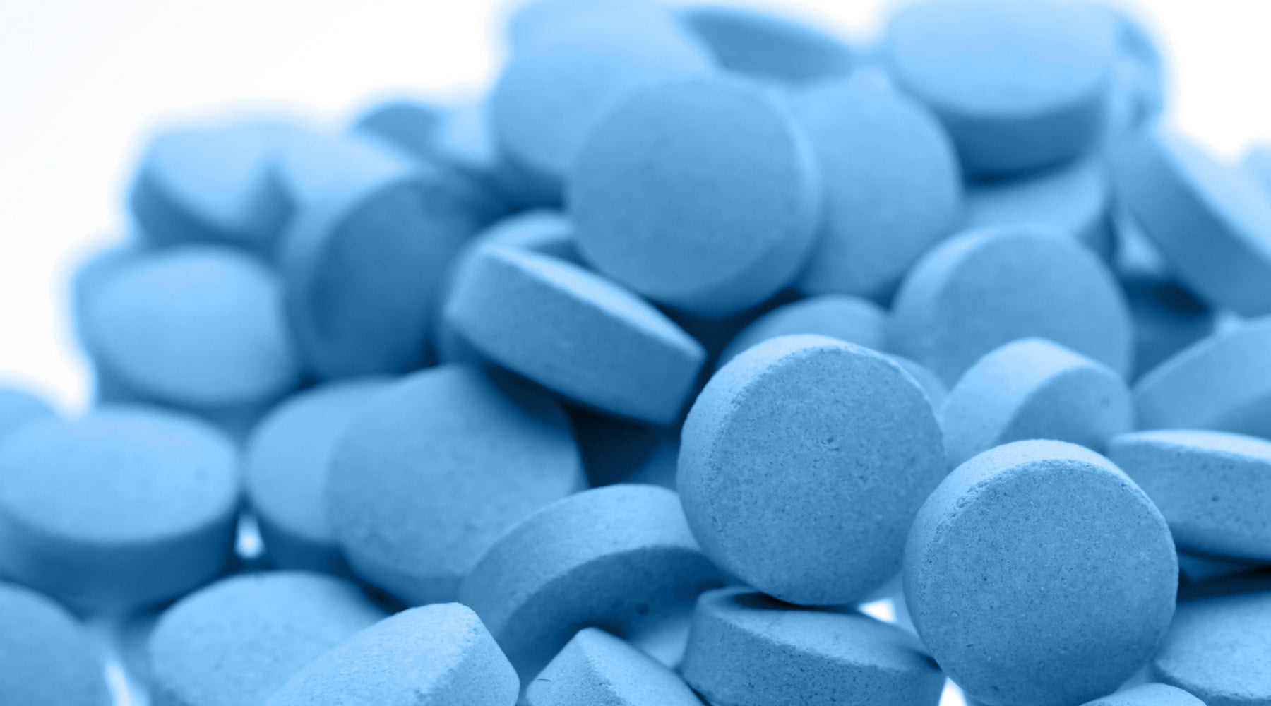 blue zantac pills on white background