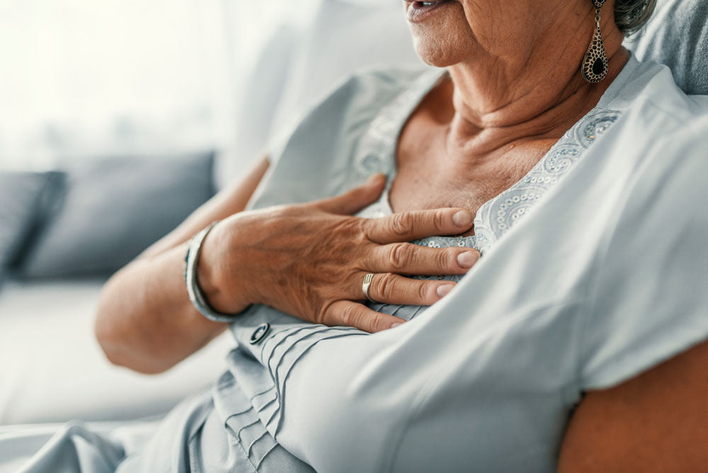 Senior woman suffering from chest discomfort symptoms as a result of GERD.