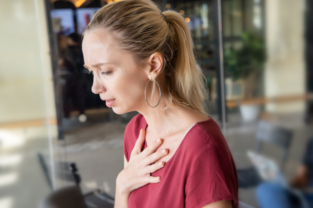 woman having chest pains from PPIs