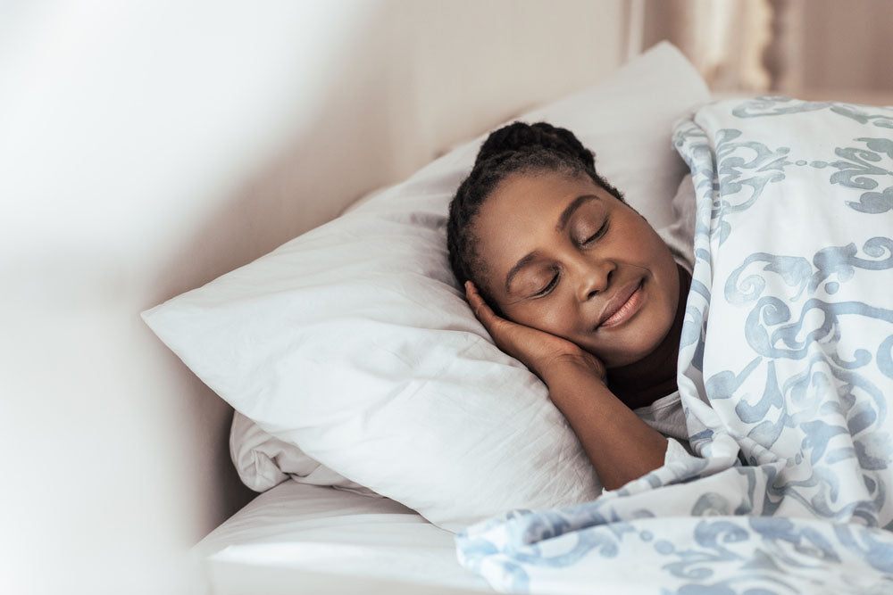 Woman comfortably sleeping on her pillow