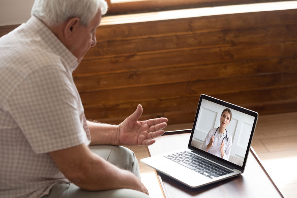 man on video call with his doctor