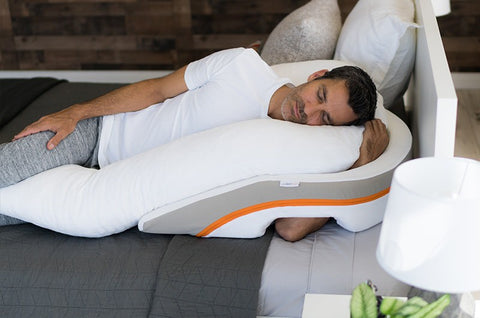 man sleeping on reflux relief pillow