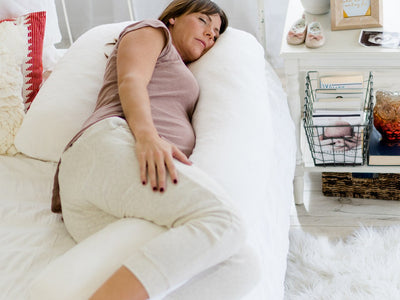 pregnant woman on medcline body pillow