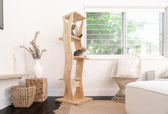 cat tree is balanced and secured to hold up to the weight of larger cats
