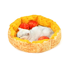 White cat sleeping inside Pizza cat bed with 3 pepperoni pillows