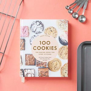 100 Cookies cookbook with baking pan and spoons