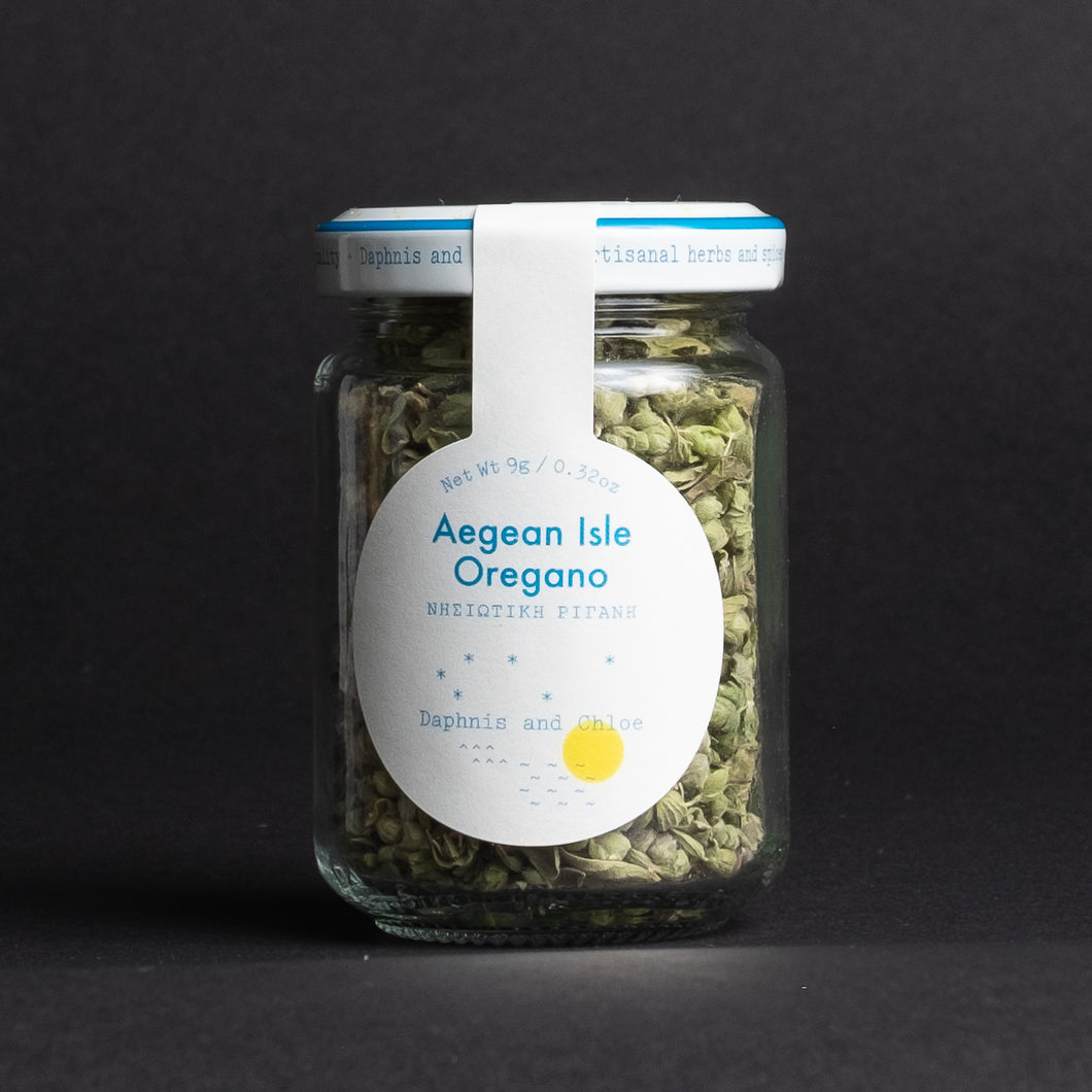 Daphnis & Chloe Aegean Isle Oregano in glass jar in front of black background