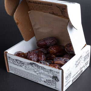 A box of Rancho Meladuco dates in a box open and showing the dates inside