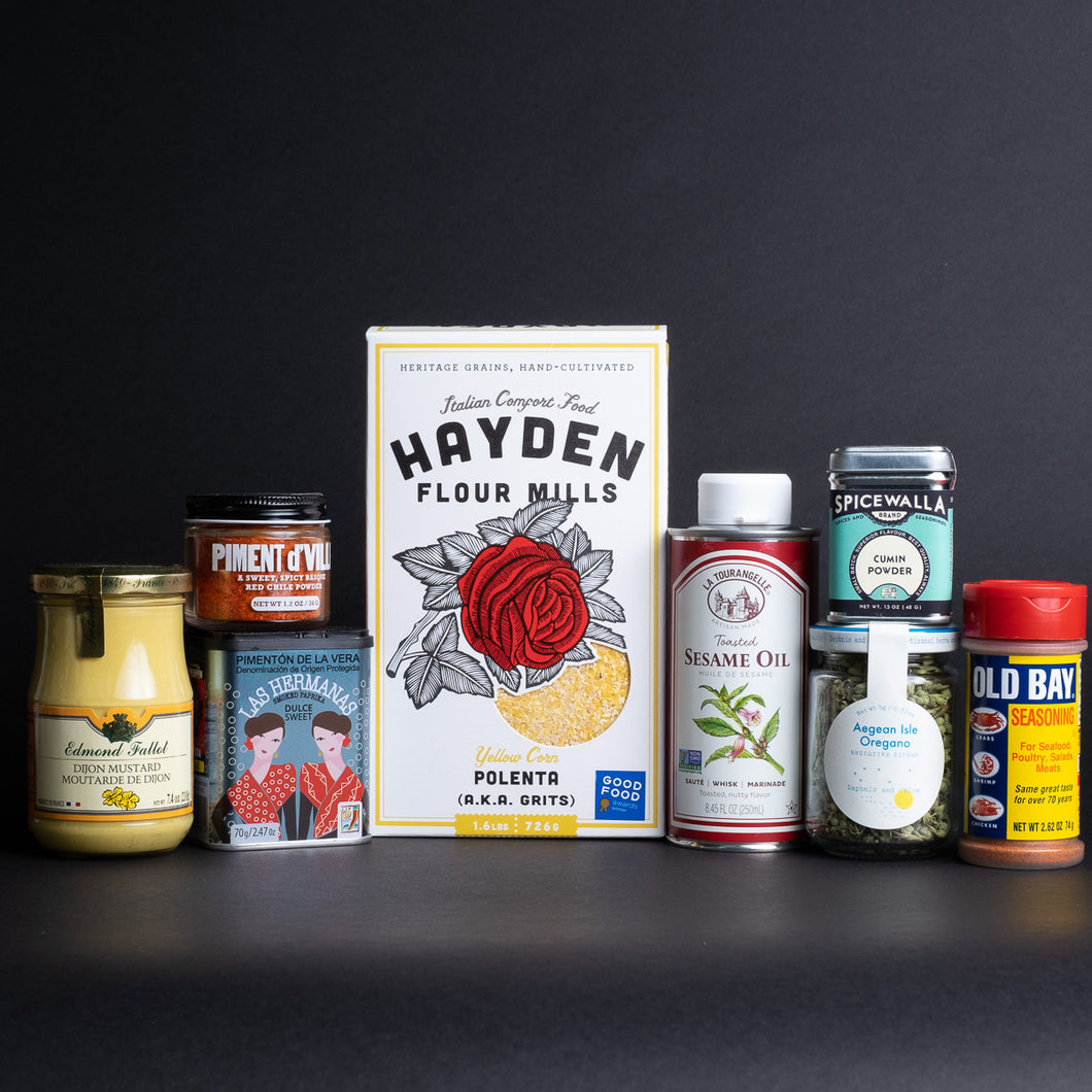 An assortment of pantry products lined up in front of a black background