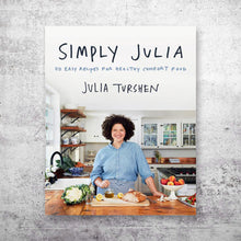 Load image into Gallery viewer, Simply Julia cookbook cover on top of grey concrete background