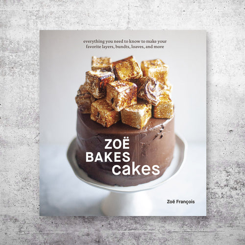 Zoe Bakes Cakes cookbook cover over a grey backround