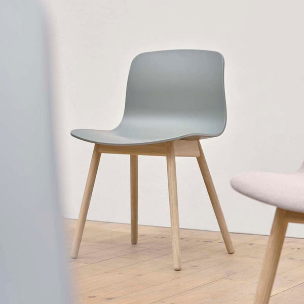 With its gently curved open shell and symmetrical solid base, the About A Chair AAC 12 design offers a refreshingly pared back expression that is consistent with the rest of the series. The lack of armrests ensures a clean, clutter-free silhouette, whilst the shaped back provides optimal comfort. The wooden frame with elegant, rounded legs conveys warmth and character, and ensures greater stability and a longer lifetime.