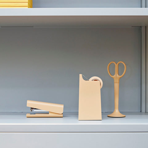 Michael Sodeau's functional collection of office essentials comprises a stapler, tape dispenser and scissors in a stand. Featuring a plastic casing and available in three different colours.