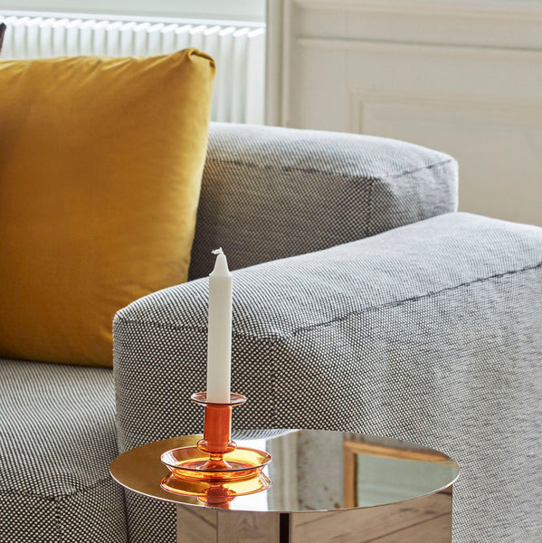 Coloured borosilicate glass with a 'tinted' rim creates an elegant and distinct design in HAY's Flare Candleholder. The candleholders are available in a choice of colours.