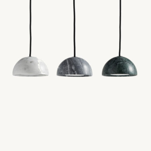 Marble Pendant is a pendant lamp made from marble to create a simple hemispherical shape. The hemisphere has a recessed removable flat LED light source that produces both downward light and a diffused side light that allows the edge of the marble to be illuminated. The light fitting is dimmable, long lasting and easy to change.