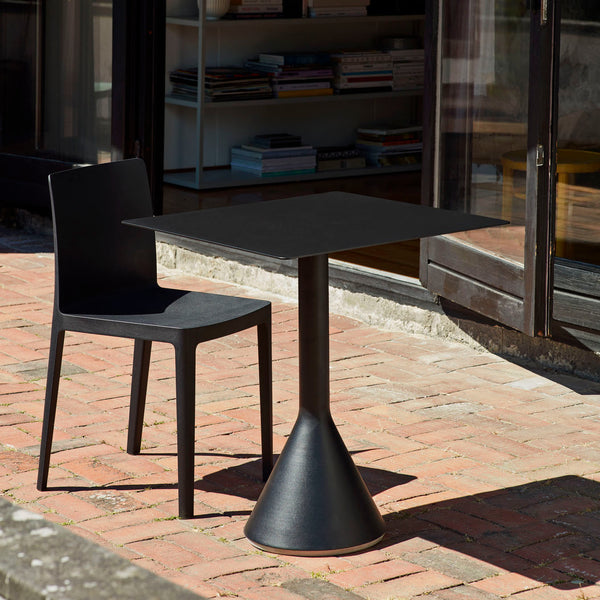 Based on the desire to develop a series of tables to complement the Palissade outdoor furniture collection, French design duo Ronan and Erwan Bouroullec teamed up with HAY to create the Cone Table. Its solid base and ultra-thin steel tabletop share the same graphic design idiom as the rest of the series, enabling the table to be strong without being bulky and elegant without being fragile.
