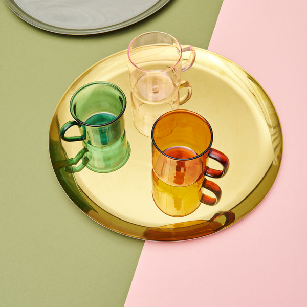 A simple, circular shape with a lustrous rainbow or gold finish results in this functional and decorative tray. HAY's Serving Tray is made in stainless steel and can be used for desks and miscellaneous household objects.
