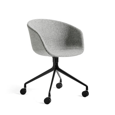 The solid rounded shell and unified silhouette of the About A Chair AAC 25 adds executive weight and brings a warm, welcoming expression to the otherwise functional and technical genre of office chairs. The stylish, functional design combined with the elegant swivel four-star castor base makes it perfect for formal or official settings and work-at-home offices. The polypropylene shell is available in a large number of colour and upholstery options and the base comes in various finishes.
