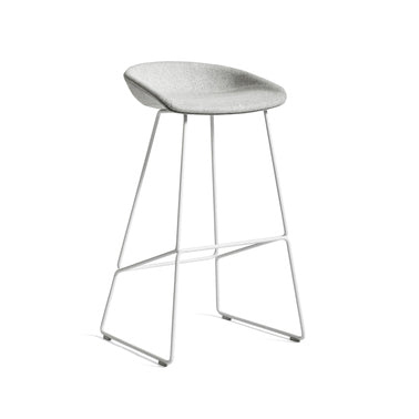 The bar stool About A Stool AAS39 has the same capacity for transformation as the other members in the series, ranging from a minimalistic plastic stool to a more full-bodied upholstered version. The curved backrest is balanced on an elegant rounded frame in metal, showcasing a more industrial design with a strong visual presence. Suitable for as using as a bar stool in bars and restaurants, as well as at home for informal meals.