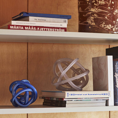Coloured glass twisted into a knot makes an original miniature sculpture that can be used for purely ornamental purposes or double up as a decorative paperweight or bookend. Glass Knot is available in assorted sizes and colours.
