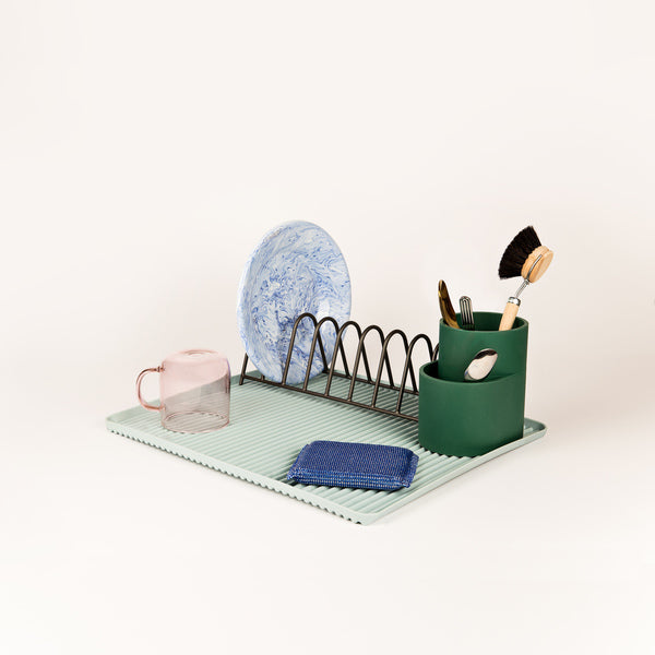 A trio of functional designs for draining the dishes, Shane Schneck's Dish Drainer comprises a ridged melamine tray, steel plate rack and silicone cutlery holder. The contrasting shapes, materials and colours add visual interest to this everyday kitchen essential.