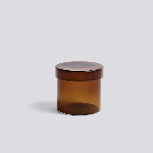 The HAY Container is a practical glass jar with matching lid designed for organizing and storing small items. Available in three sizes in many different tones of glass.