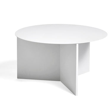 HAY's Slit Table is a geometric steel side table inspired by paper origami techniques. The slim frame appears folded beneath the tabletop, creating a simple yet sculptural form that is reminiscent of traditional Japanese paper art. The Slit Table is available in a selection of different shapes and sizes and is offered in a variety of contemporary colours and finishes. Compact and versatile, it can be used on its own or arranged in clusters in diverse private or public settings.