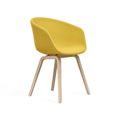 The About A Chair AAC 23 design exudes the functional simplicity that is characteristic of this entire series. The solid shell comprises a curved back with armrests in polypropylene, providing excellent comfort and a soft, unified silhouette, while the four-legged wooden base adds a timeless, classic expression, ensuring greater stability and a longer lifetime.