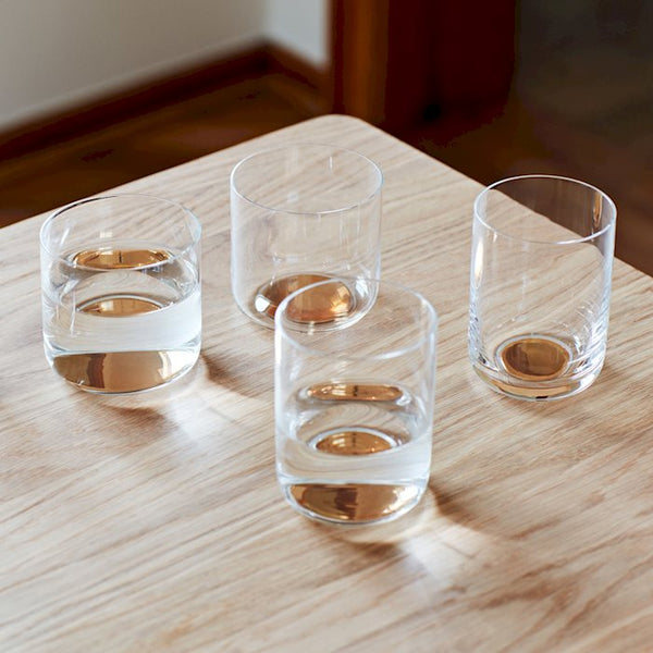 Colour Glass is a collection of drinking glasses in Scholten & Baijings' characteristic colour universe. Golden dots on the base. Solid colour patches and delicate golden grids. Soft gradual transitions between colour and glass in water glasses, wine glasses and carafes. The collection has a minimalist expression but exuberant decoration and colours in cross-combinations of patterns, colours and functions.