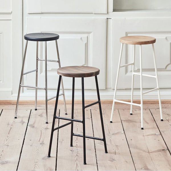 Jonas Trampedach's Cornet Bar Stool is a classic bar stool using an innovative steel tube technique inspired by bicycle racks. The round solid oak seat rests on a slender steel base, creating an interesting balance of proportions and profiles. The stools come in two different heights, with choice of wood finishes for the seat and chrome or powder coated colour options for the legs. The stools are suitable for bars, islands and worktops in a number of private and public settings.
