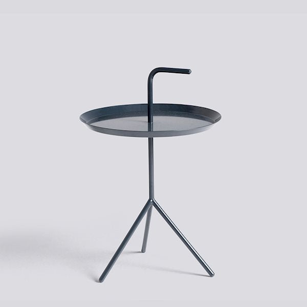 Thomas Bentzen's portable side table is aptly named 'Don't Leave Me'. Abbreviated to DLM, it features a convenient handle that allows the metal table to be carried from room to room. Although it has a lightweight and portable structure, the three slanted legs provide great stability.