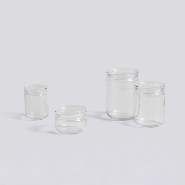 This series of Japanese Glass Jars has a simple, see-through, stackable design with four different sizes and an acrylic lid.
